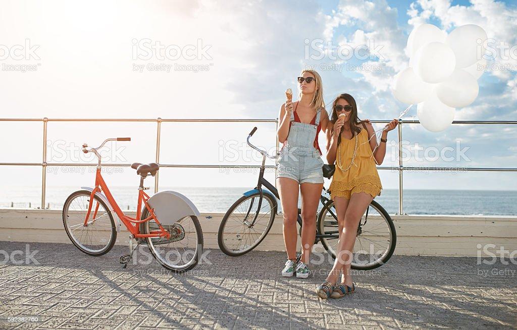 Best friends enjoying a holiday on seaside promenade - Photo