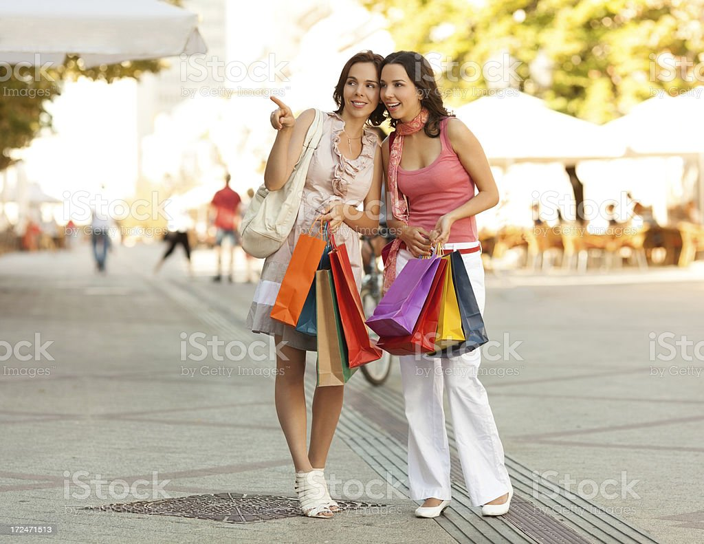 Best friends enjoying shopping royalty-free stock photo