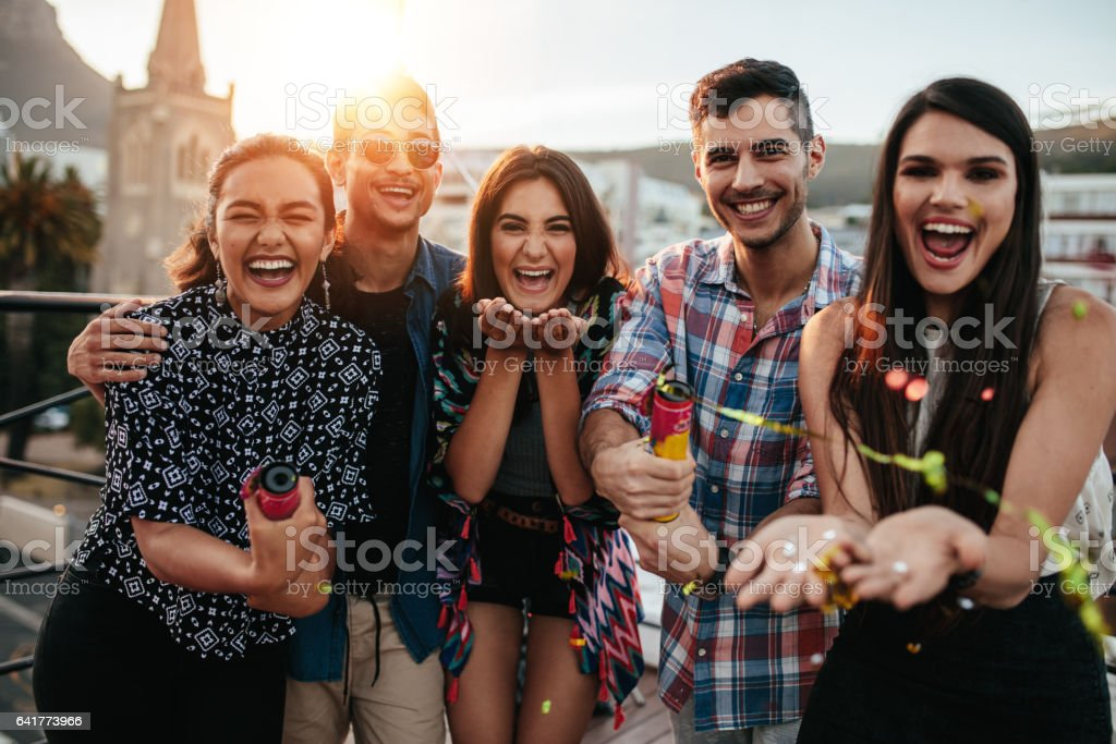 Best friends enjoying the party together with confetti stock photo