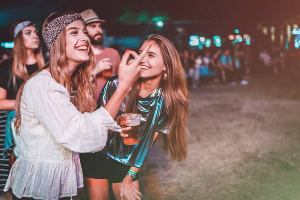 Best friends having fun at the summer music festival stock photo
