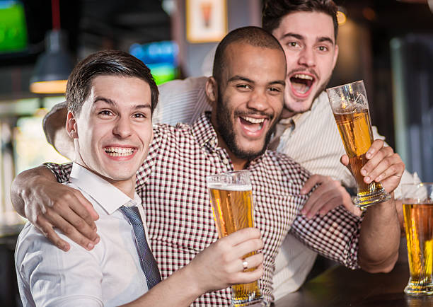 best friends in a bar. men shout and rejoice - after work stock photos and pictures
