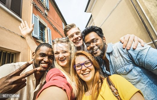 861023492 istock photo Best friends multiracial people taking selfie outdoors - Happy friendship concept with young students having fun together - Peace and love against racism - International exchange concept - Warm filter 927124396