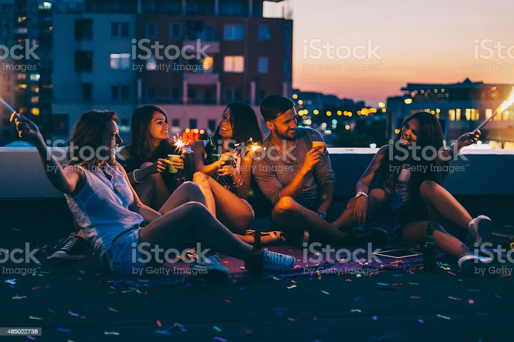 Best friends on a rooftop party royalty-free stock photo