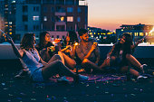 Best friends on a rooftop party
