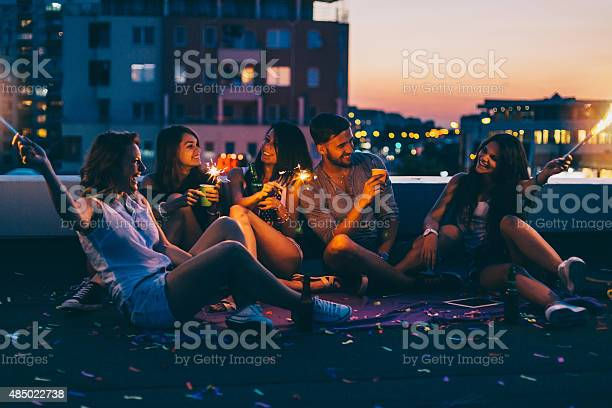 Photo of Best friends on a rooftop party