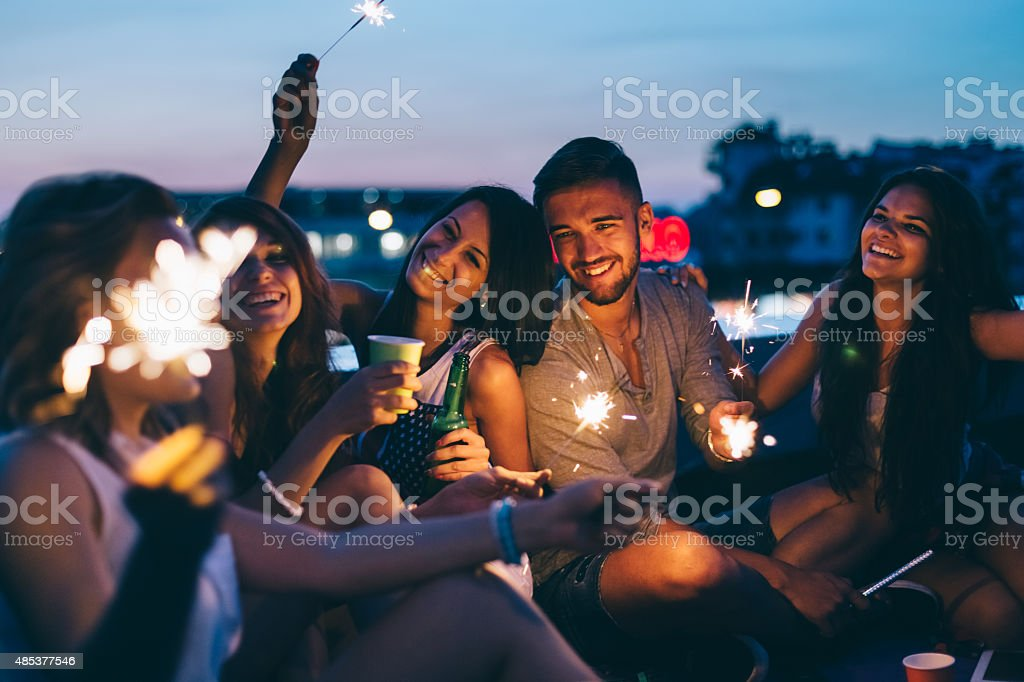 Best friends on a rooftop party stock photo