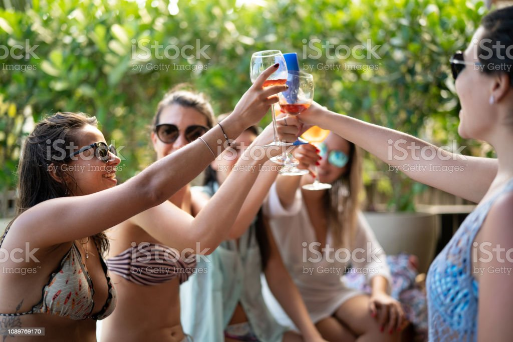 Best Friends on Celebratory Toast with Aperol at Beach House stock photo