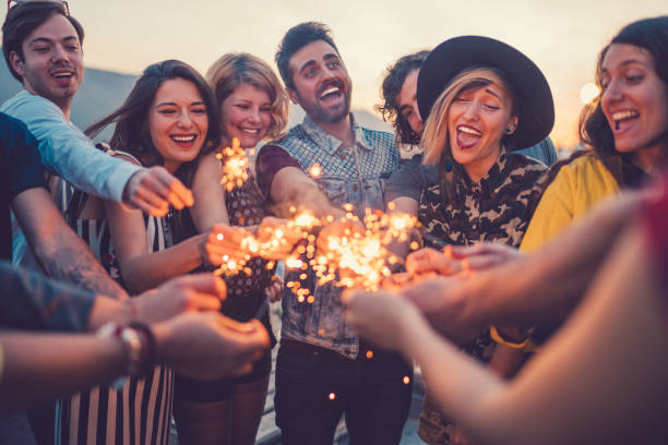 Best friends partying on rooftop stock photo