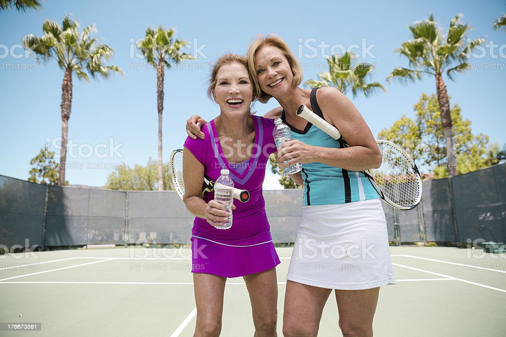 Best friends playing tennis royalty-free stock photo