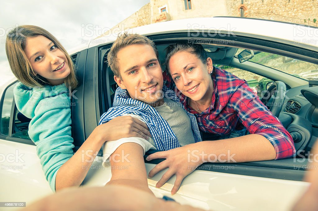 Best friends taking selfie at car trip stock photo