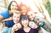 istock Best friends taking selfie at picnic with back lighting - Happy youth friendship concept against racism with young people having fun together - Vintage desaturated filter with sunshine halo flare 937881218