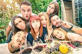 Best friends taking selfie outdoor at winery tasting wine
