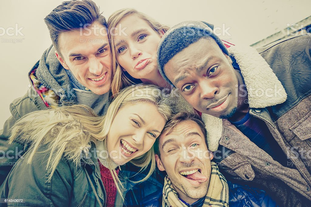 Best friends taking selfie outdoor on autumn winter clothes stock photo
