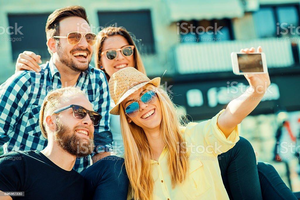 Best friends taking selfie outdoors royalty-free stock photo