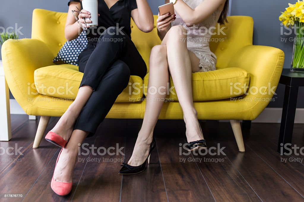 Best friends tell secrets over coffee stock photo