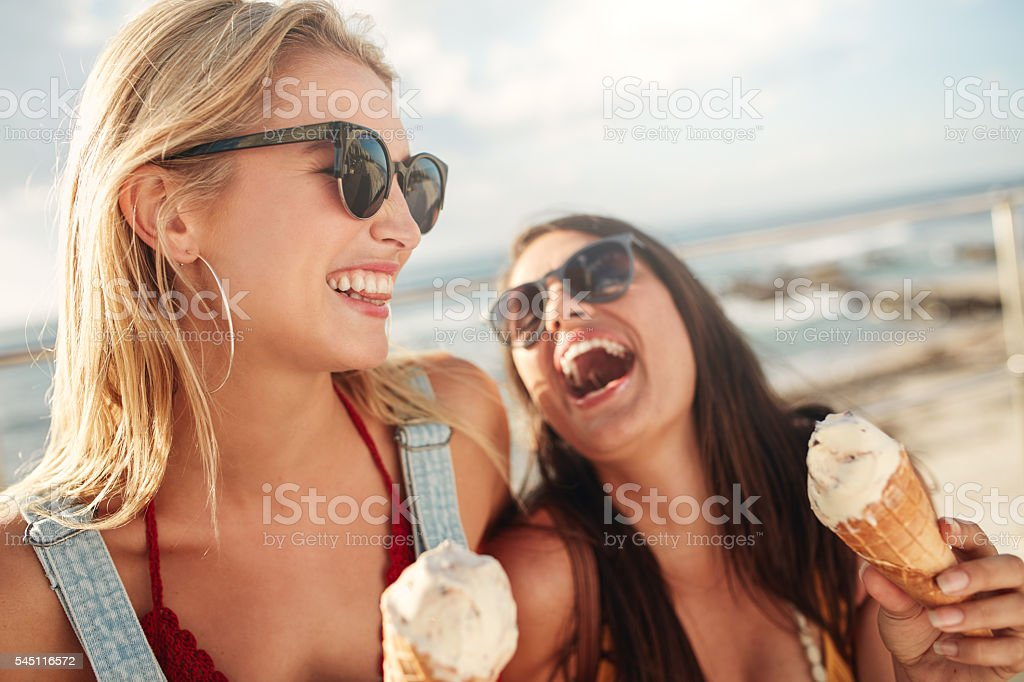 Best friends together outdoors with ice cream - Photo