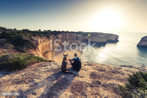 istock Best friends travellers sitting at cliffs in Portugal 862007136