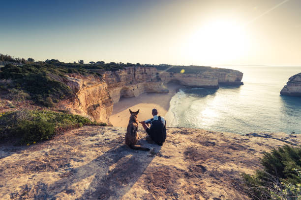 Best friends travellers sitting at cliffs in portugal picture id862007136?b=1&k=6&m=862007136&s=612x612&w=0&h=jrnu7ovkpu gvbaunwtfj9hfnmdg8mjdpt1tliqzqwo=