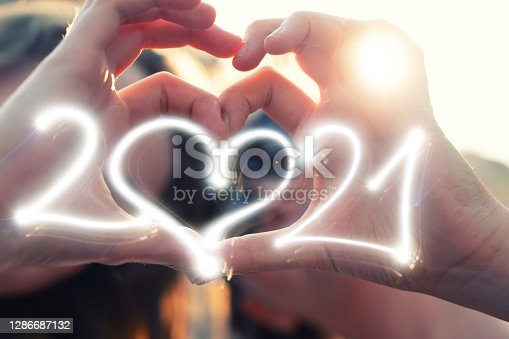 Best girlfriends making heart shaped hands with Sparkler 2021