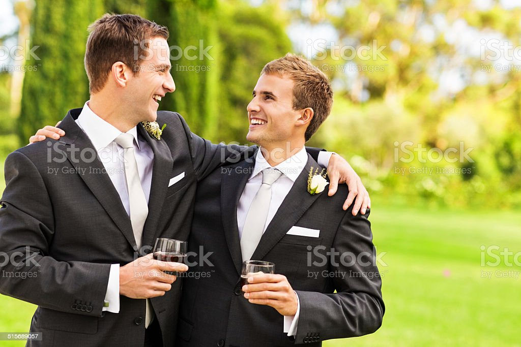 Best Man And Groom With Whisky Glasses In Garden stock photo
