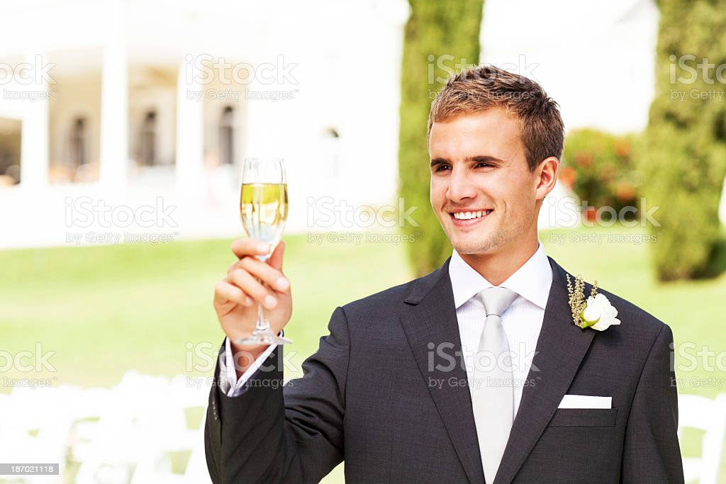 Best Man Champagne Flute At Garden Wedding royalty-free stock photo