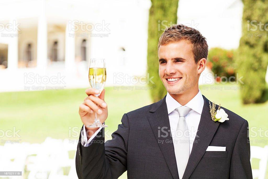Best Man Champagne Flute At Garden Wedding stock photo