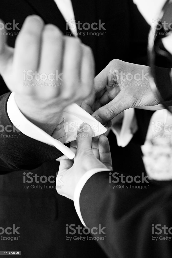 Best Man Helping Groom with Cuff links stock photo