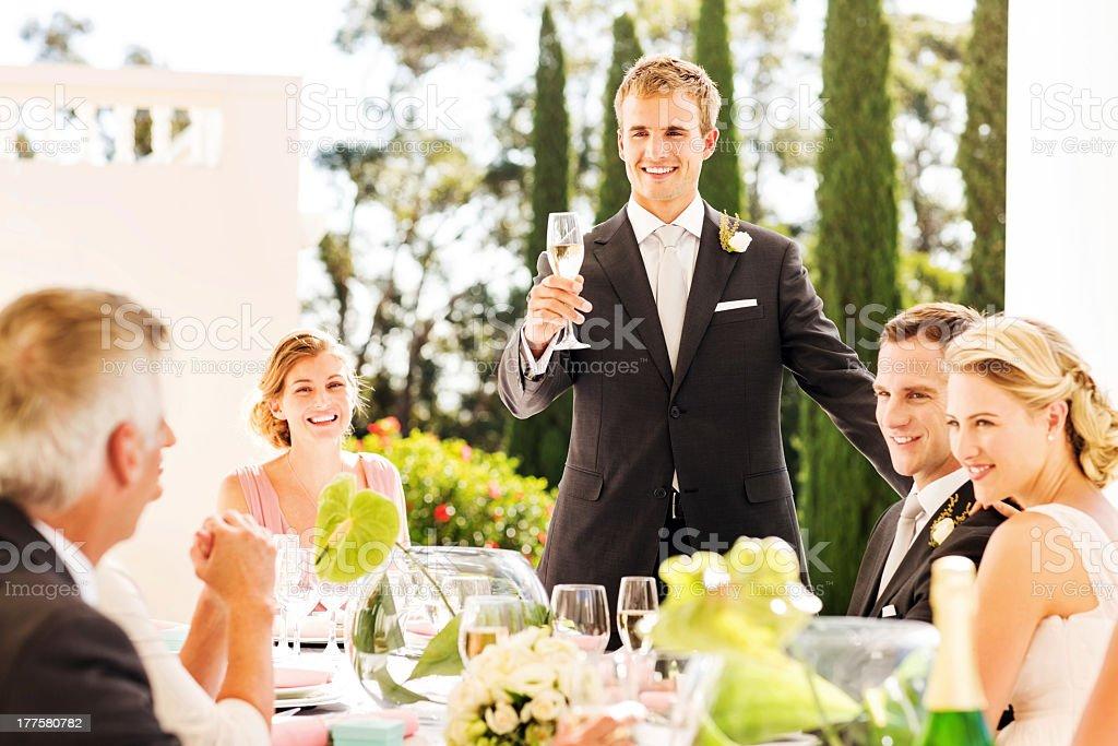 Best Man Raising A Toast During Wedding Reception stock photo