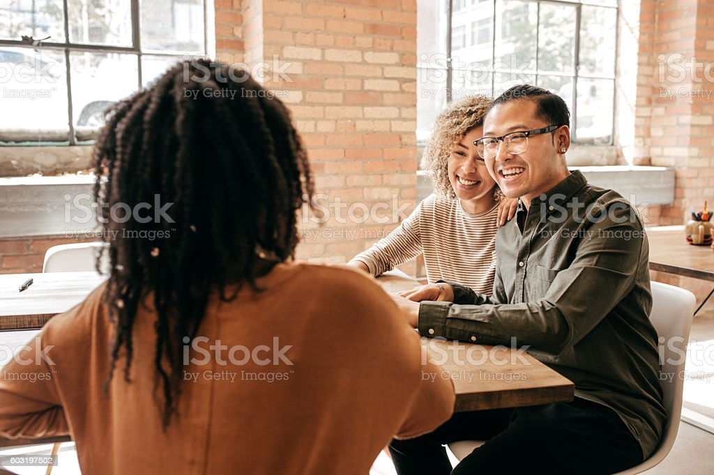 Couple meeting mortgage professional