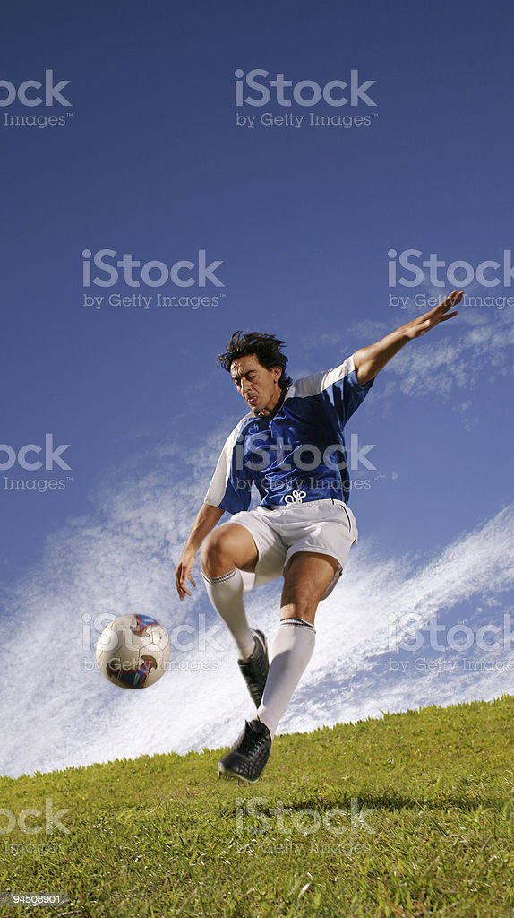 Best soccer player hitting the ball royalty-free stock photo