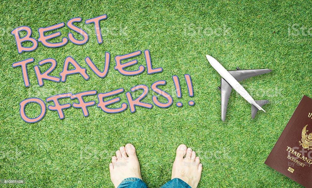 Best Travel offer banner with green grass background stock photo
