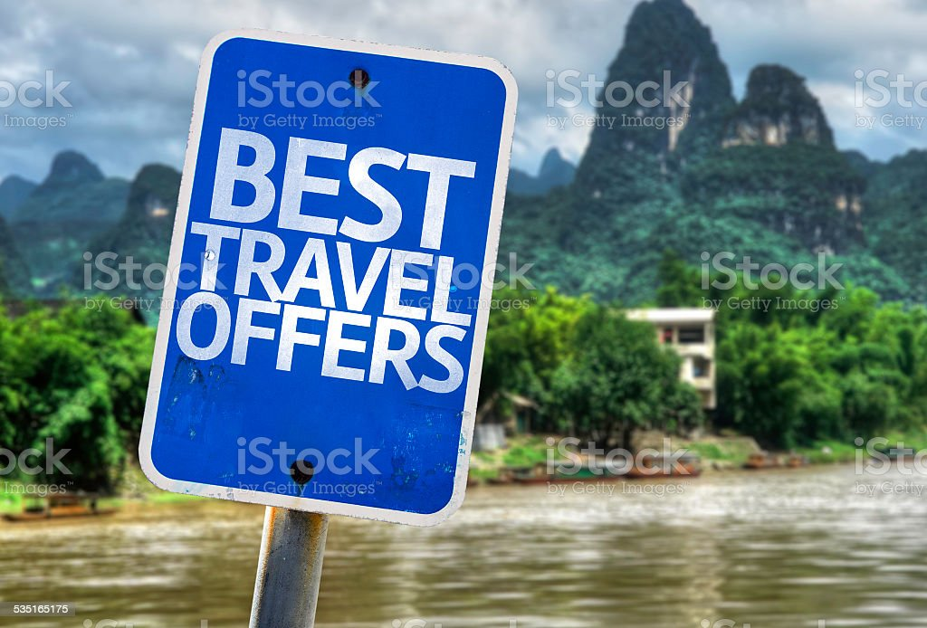 Best Travel Offers sign with a forest background stock photo