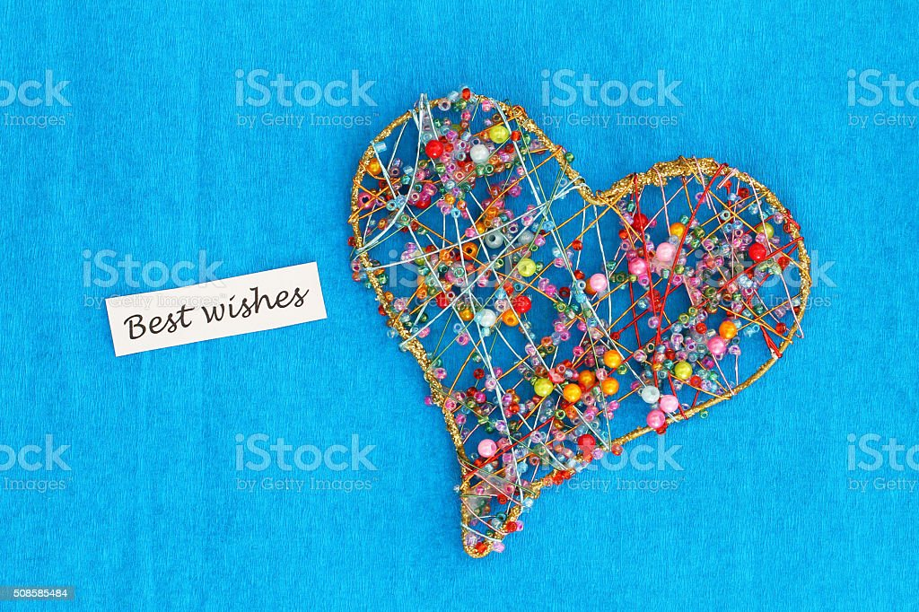 Best wishes card with heart made of colorful beads stock photo