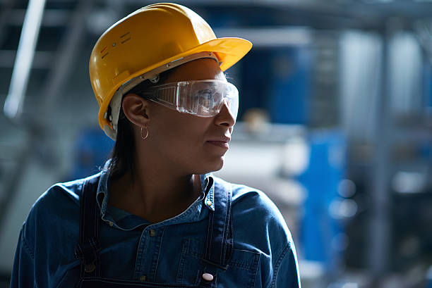 Best worker African woman finding strengths to finish work protective eyewear stock pictures, royalty-free photos & images