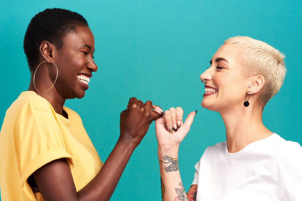 besties forever through whatever - pinky promise stock photos and pictures
