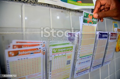 salvador, bahia, brazil - february 15, 2021: customers in a lottery agency in the city center of Salvador place a bet on the accumulated Maga Sena.