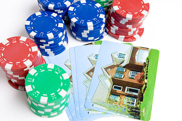 Bet the house - Poker Chips, Playing Cards with Home stock photo