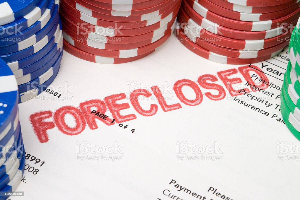 Bet the House, Stacks of Poker Chips on Foreclosed Mortgage royalty-free stock photo