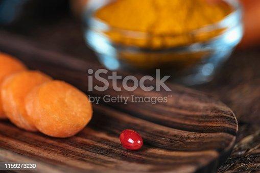 istock Beta Carotene Supplement Pills and Vegetables 1159273230