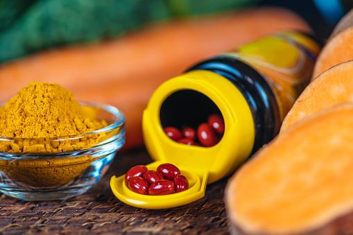 istock Beta Carotene Supplement Pills and Vegetables 1159274401