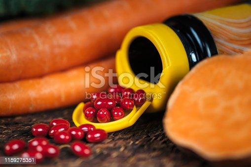 istock Beta Carotene Supplement Pills and Vegetables 1159275351
