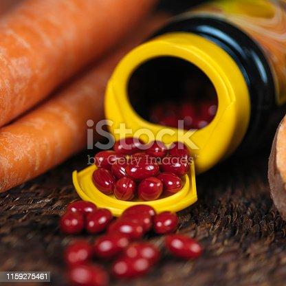 istock Beta Carotene Supplement Pills and Vegetables 1159275461