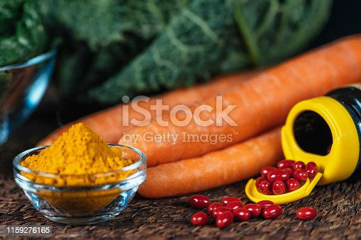istock Beta Carotene Supplement Pills and Vegetables 1159276165