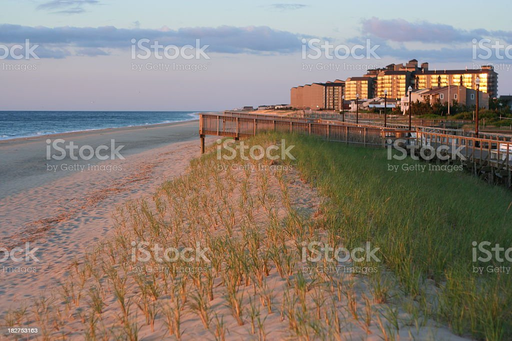 Bethany beach with boardwalk and building in the distance stock photo