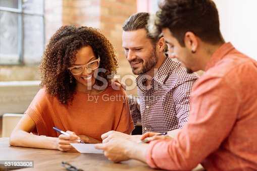 Smiling couple with mortgage agent