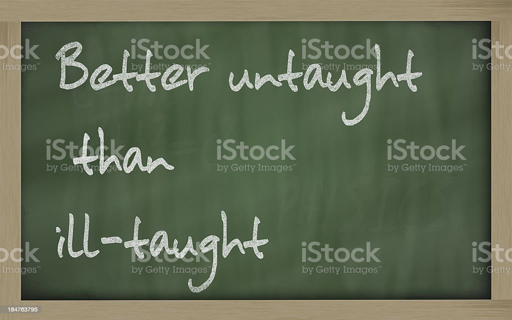 Better untaught than ill-taught written on a blackboard stock photo