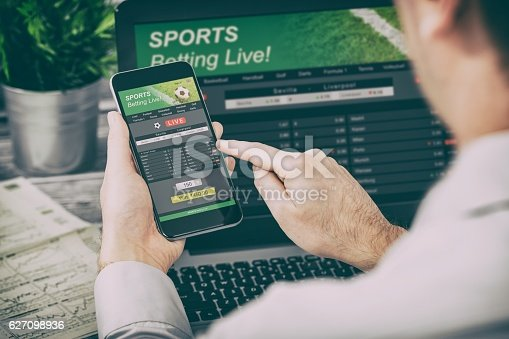 istock betting bet sport phone gamble laptop concept 627098936