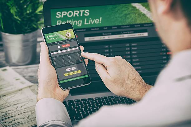 betting bet sport phone gamble laptop concept - mobiles internet stock-fotos und bilder