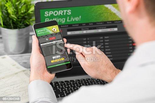 istock betting bet sport phone gamble laptop concept 664364348