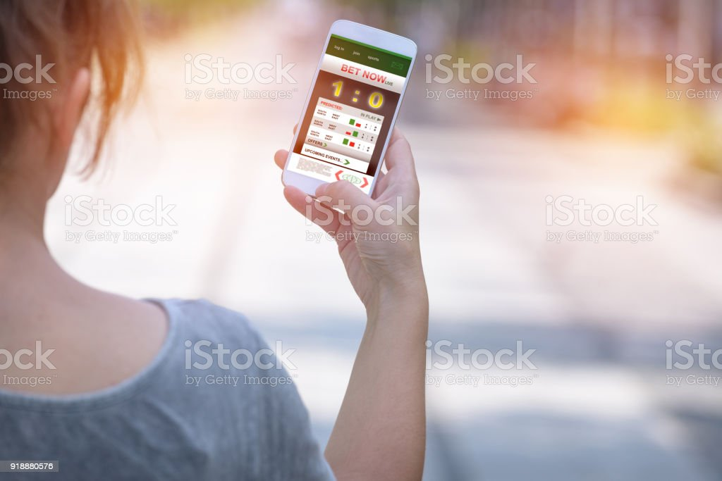 Betting on sports with smartphone stock photo
